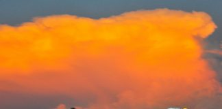 Matt Westfall races under a colorful sky Friday night at Gas City I-69 Speedway. (Randy Crist Photo)