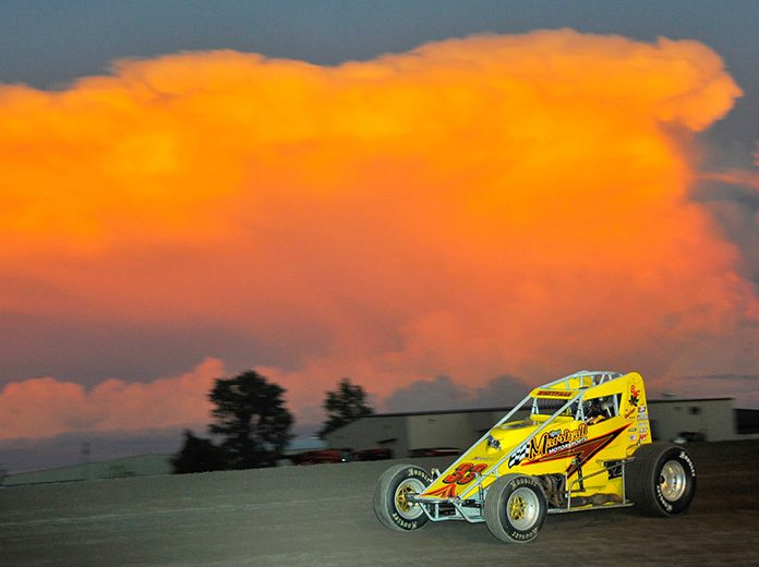 Matt Westfall races under a colorful sky Friday night at Gas City I-69 Speedway. (Randy Crist Photo)