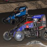 Logan Seavey (67) races past Tanner Carrick en route to victory Saturday at Macon Speedway. (Brendon Bauman Photo)