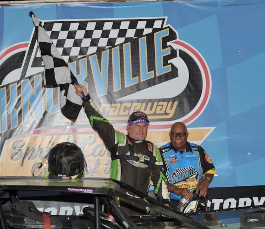 Jimmy Owens in victory lane with flag man Doug Clark. (Knoxville Raceway photo)