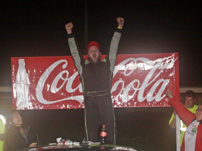 Rich Dubeau celebrates after winning the Labor Day Classic Saturday at Thunder Road Int'l Speedbowl. (Alan Ward Photo)