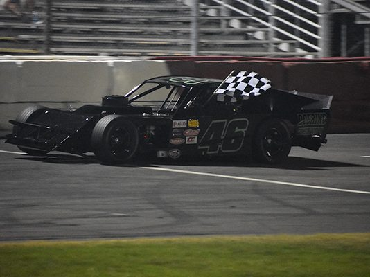Derrick Doering celebrates his Modified win Saturday night at All-American Speedway. (Don Thompson Photo)