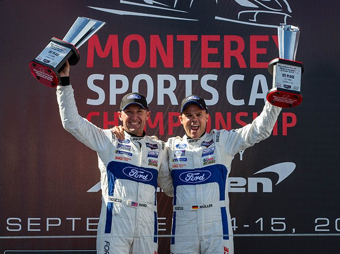 Dirk Mueller and Joey Hand celebrate their GT Le Mans victory Sunday at WeatherTech Raceway Laguna Seca. (Sarah Weeks Photo)