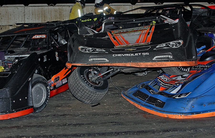 Safety crews attend to several damaged cars after a crash in Saturday's American Ethanol Late Model Tour Fall Special at Hartford Speedway. (Jim Denhamer Photo)