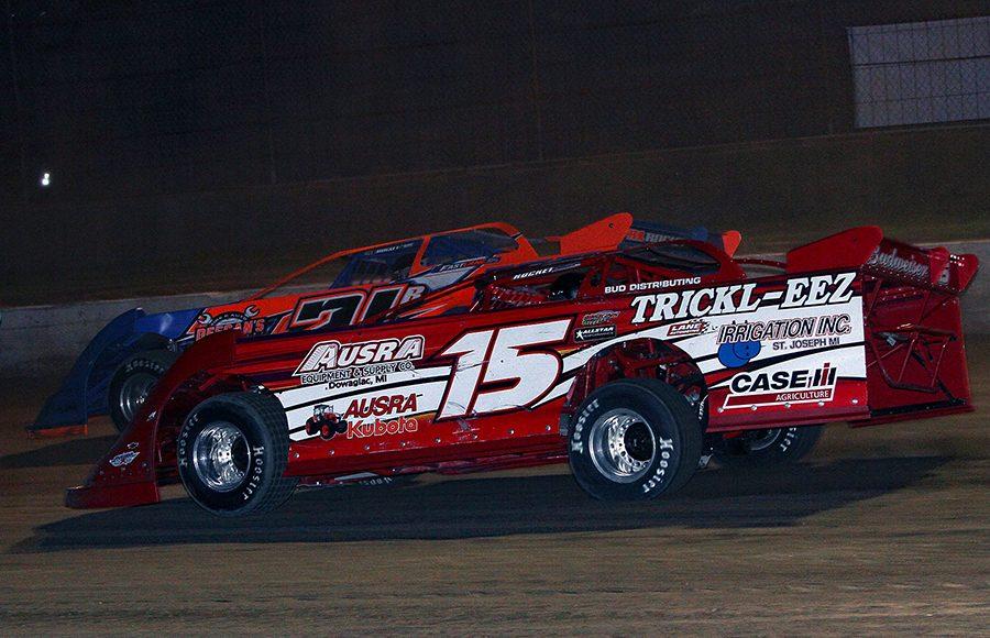 Phil Ausra (15) battles alongside Rich Bell during Saturday's American Ethanol Late Model Tour Fall Special at Hartford Speedway. (Jim Denhamer Photo)