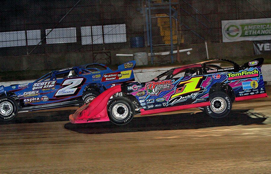 Rusty Schlenk (1) races under Travis Stemler during Saturday's American Ethanol Late Model Tour Fall Special at Hartford Speedway. (Jim Denhamer Photo)