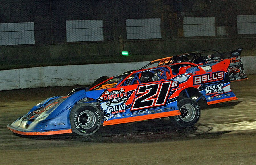 Rich Bell (21) races past David Mielke during Saturday's American Ethanol Late Model Tour Fall Special at Hartford Speedway. (Jim Denhamer Photo)