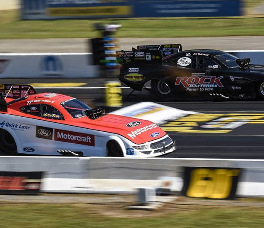 Bob Tasca III (near lane) battles John Smith during NHRA Funny Car eliminations as part of the Mopar Express Lane NHRA Nationals at Maple Grove Raceway. (Dennis Bicksler Photo)