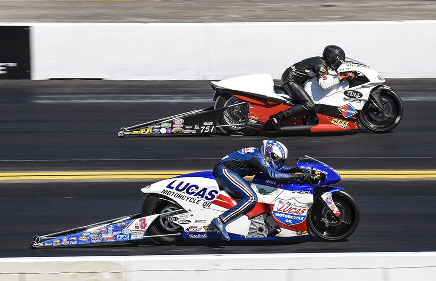 Hector Arana Jr. (near lane) battles Steve Johnson during Pro Stock Motorcycle eliminations as part of the Mopar Express Lane NHRA Nationals at Maple Grove Raceway. (Dennis Bicksler Photo)