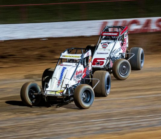 Brady Bacon leads Mario Clouser (6) at Lucas Oil Speedway. (POWRi photo)