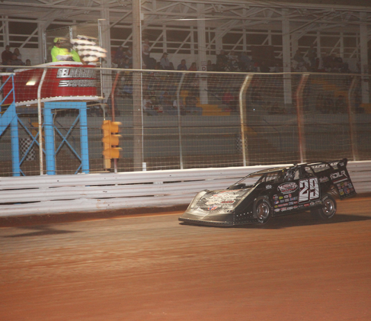 Darrell Lanigan takes the checkered flag at Selinsgrove Speedway. (Rick Neff photo)