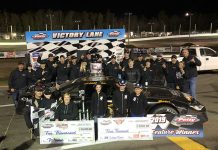 Jonathan Hicken and his team celebrate after winning the Mike Stevens Memorial Saturday at Petty Int'l Raceway.