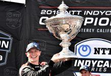 Josef Newgarden hoists the Astor Cup after winning the NTT IndyCar Series title. (Al Steinberg Photo)