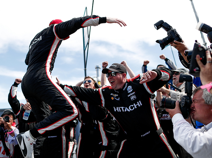 Josef Newgarden jumps into the arms of his crew after winning the NTT IndyCar Series championship. (IndyCar Photo)