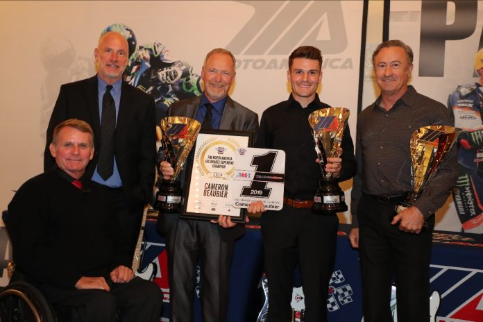 (From left to right) MotoAmerica President Wayne Rainey, AMA Chief Operating Officer Jeff Massey, crew chief Rick Hobbs, Cameron Beaubier and team manager Tom Halverson celebrate Beaubier's Superbike Championship at the Night of Champions. (Brian J. Nelson Photo)