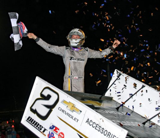 Carson Macedo celebrates winning Wednesday's World of Outlaws feature at Jacksonville (Ill.) Speedway. (Jim DenHamer photo)