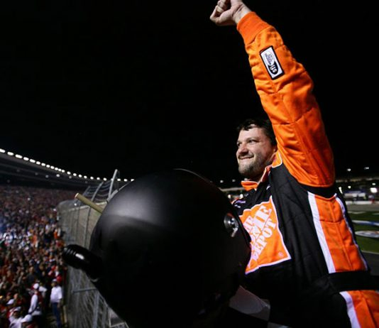 Tony Stewart celebrates in the starter's box after winning the 2006 NASCAR Cup Series Dickies 500 at Texas Motor Speedway. (Getty Images Photo)