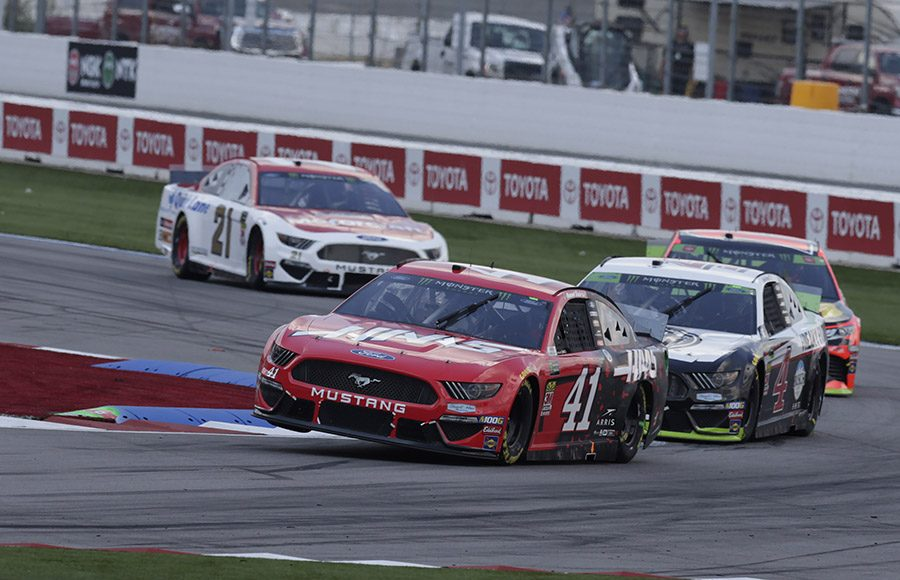 Daniel Suarez (41) leads a pack of cars through a corner during Sunday's Bank of America ROVAL 400 at Charlotte Motor Speedway. (HHP/Garry Eller Photo)