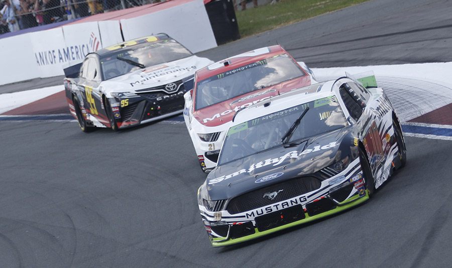 Aric Almirola (10) leads Paul Menard (21) and Matt DiBenedetto during Sunday's Bank of America ROVAL 400 at Charlotte Motor Speedway. (HHP/Ashley Dickerson Photo)