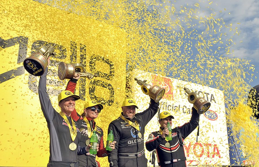 (From left) Karen Stoffer, Erica Enders, Shawn Langdon and Billy Torrence celebrate victories during the AAA Insurance NHRA Midwest Nationals at World Wide Technology Raceway on Sunday. (Shawn Crose Photo)