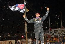 Brandon Overton celebrates his victory in the Mike Duvall Memorial Friday at Cherokee Speedway. (Jim Denhamer Photo)