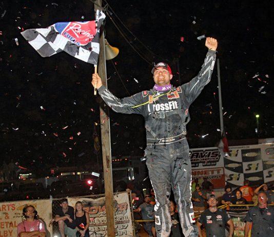 Brandon Overton celebrates his victory in the Mike Duvall Memorial Friday at Cherokee Speedway. (Jim Denhamer Photo)