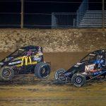 Kevin Thomas Jr. (19) leads Justin Grant at Lawrenceburg Speedway. (Dallas Breeze photo)