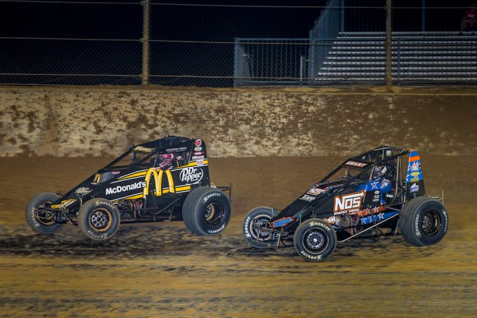 Kevin Thomas Jr. (19) leads Justin Grant at Lawrenceburg Speedway. (Dallas Breeze photo)