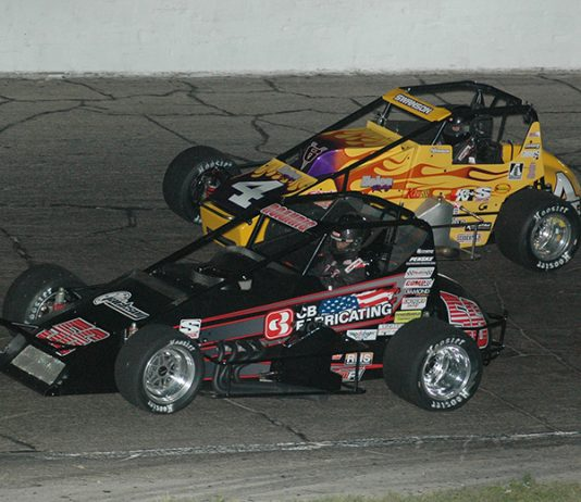 Tyler Roahrig (56) battles Kody Swanson Saturday night at Anderson Speedway. (David Sink Photo)