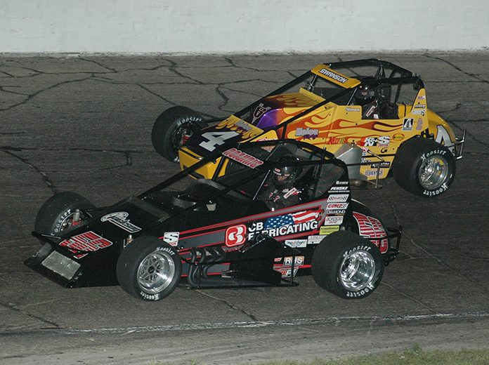 Tyler Roahrig (56) battles Kody Swanson Saturday night at Anderson Speedway. (David Sink Photo)