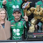 Kyle Larson and his wife, Katelyn, pose in victory lane after Sunday's Drydene 400 at Dover Int'l Speedway. (Dave Moulthrop Photo)