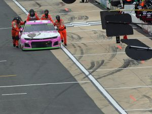 Chase Elliott's crew pushes him to the garage area Sunday at Dover Int'l Speedway. (Dave Moulthrop Photo)
