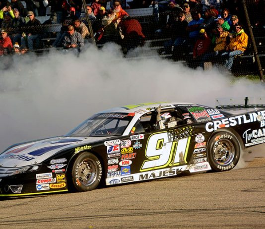 Ty Majeski does a victory burnout after winning the 50th annual Oktoberfest ARCA Midwest Tour 200 Sunday at the LaCrosse Fairgrounds Speedway in West Salem, Wis. (Stan Kalwasinski photo)