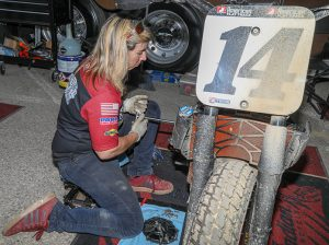 Michelle DiSalvo hard at work in the Indiana Motorcycle pit. (Indian Photo)