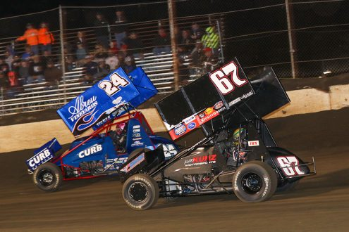 Rico Abreu (24) races ahead of Buddy Kofoid during Saturday's Built Ford Tough MOWA Sprint Car Series feature at Jacksonville Speedway. (Brendon Bauman Photo)
