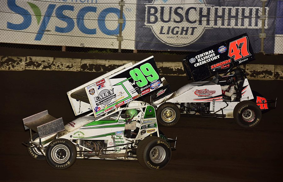 Korey Weyant (99) races past Terry Babb during Saturday's Built Ford Tough MOWA Sprint Car Series feature at Jacksonville Speedway. (Mark Funderburk Photo)