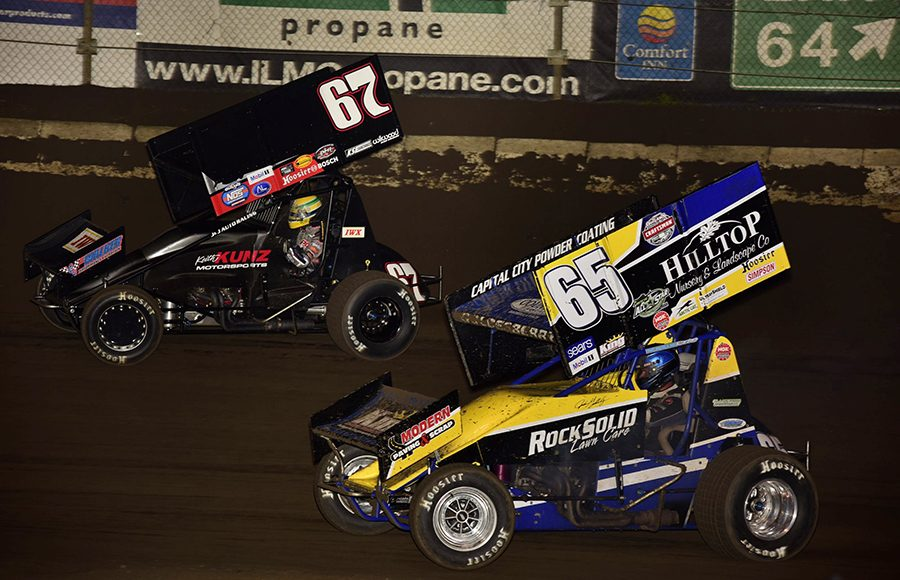 Buddy Kofoid (67) races around the outside of Jordan Goldesberry during Saturday's Built Ford Tough MOWA Sprint Car Series feature at Jacksonville Speedway. (Mark Funderburk Photo)