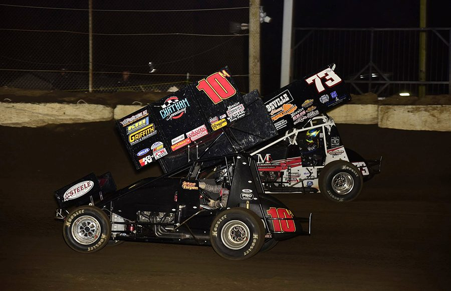 Morgan Turpen (10m) races alongside Joey Moughan during Saturday's Built Ford Tough MOWA Sprint Car Series feature at Jacksonville Speedway. (Mark Funderburk Photo)