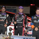 Mat Williamson (center) is joined on the podium by Erick Rudolph (right) and Mike Maresca. (DIRTcar photo)