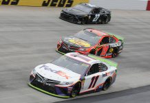 Denny Hamlin (11) and Martin Truex Jr. (19) pass the slower car of Joe Nemechek during Sunday's Drydene 400 at Dover Int'l Speedway. (Dave Moulthrop Photo)