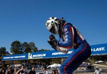Roman De Angelis celebrates his victory in Friday's Porsche GT3 Cup Challenge USA finale at Michelin Raceway Road Atlanta. (IMSA Photo)