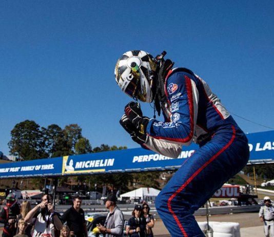Roman De Angelis celebrates his victory in Friday's Porsche GT3 Cup Challenge USA finale at Michelin Raceway Road Atlanta. (IMSA Photo)