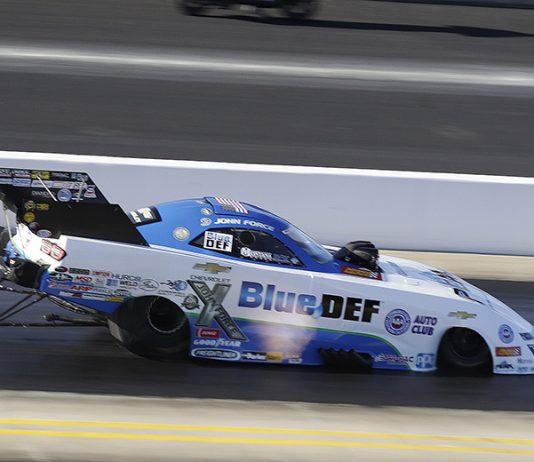 John Force at speed Friday at zMAX Dragway. (NHRA Photo)