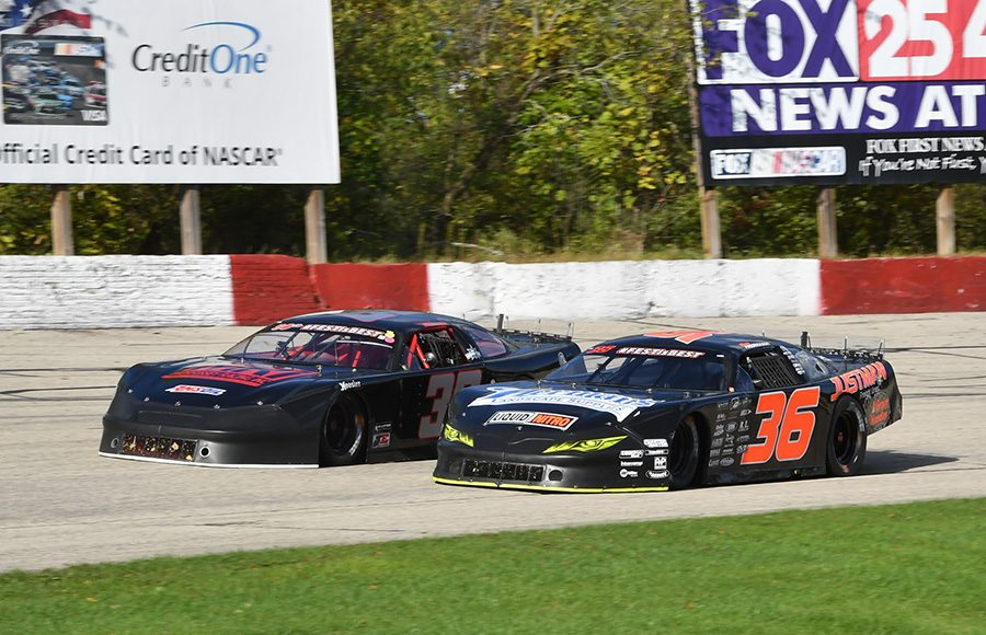 Dan Fredrickson (36) battles Andrew Morrissey during last Sunday's Oktoberfest 200 feature at LaCrosse Fairgrounds Speedway. (Doug Hornickel Photo)