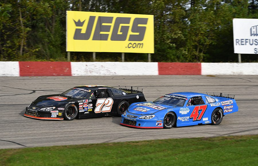 Jacob Goede (72) races around the outside Casey Johnson during last Sunday's Oktoberfest 200 feature at LaCrosse Fairgrounds Speedway. (Doug Hornickel Photo)