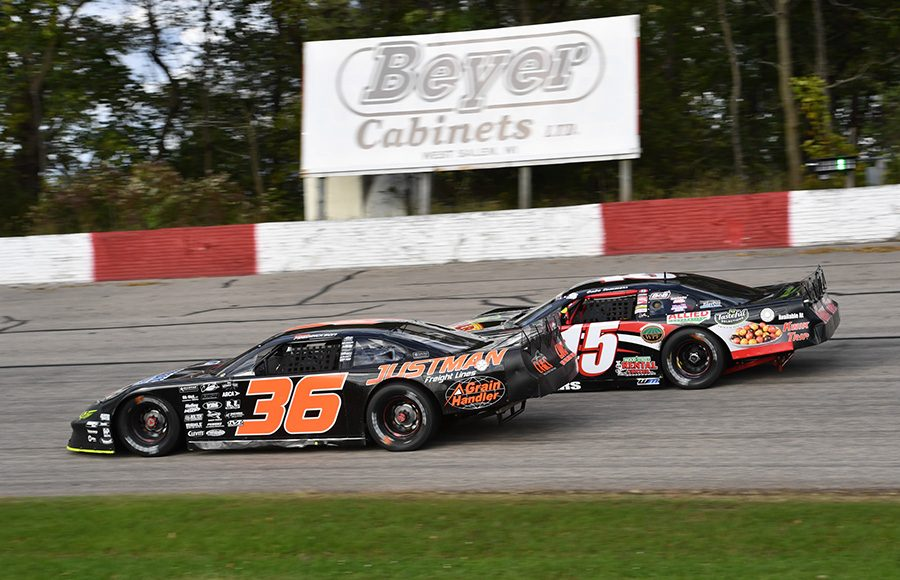 Dan Fredrickson (36) races under Gabe Sommers during last Sunday's Oktoberfest 200 feature at LaCrosse Fairgrounds Speedway. (Doug Hornickel Photo)