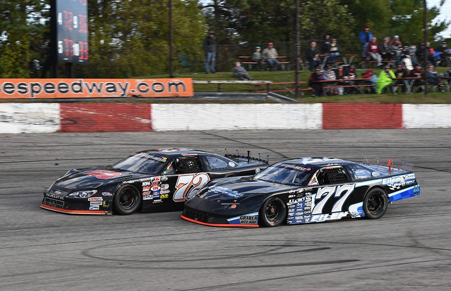 Jonathan Eilen (77) battles Jacob Goede during last Sunday's Oktoberfest 200 feature at LaCrosse Fairgrounds Speedway. (Doug Hornickel Photo)