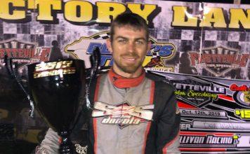 Ben Watkins in victory lane Saturday at Fayetteville Motor Speedway.