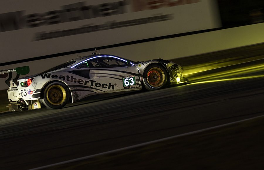 The No. 63 Ferrari 488 GT3 shared by Cooper MacNeil, Toni Vilander and Jeff Westphal speeds through the night in the Petit Le Mans. (IMSA Photo)