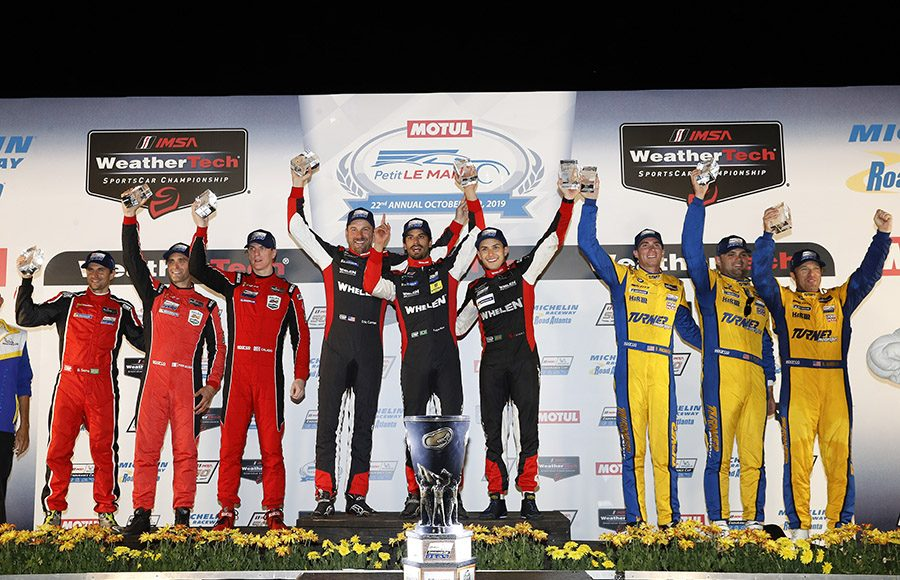 The class winners from the Petit Le Mans share the podium Saturday night at Michelin Raceway Road Atlanta. (IMSA Photo)